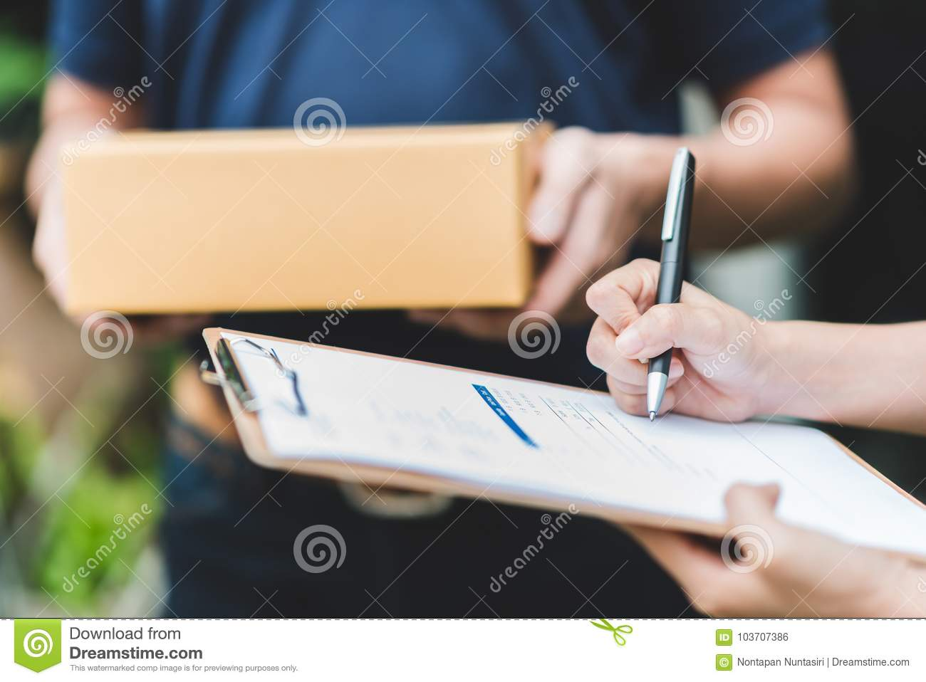hand-putting-signature-clipboard-to-rece